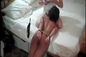 submissive woman manacled and dominated by